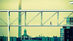 Busy man walking through the sky (manganite) Tags: bridge sky people berlin men tower topf25 digital buildings germany walking geotagged interestingness google cool xpro nikon europe tl candid guys streetscene stranger roofs explore getty d200 nikkor dslr gettyimages paullbehaus regierungsviertel marieelisabethldershaus supershot april5 interestingness116 i500 18200mmf3556 april52007 utatafeature manganite nikonstunninggallery 25faves ipernity administrationdistrict superbmasterpiece goldenphotographer date:year=2007 geo:lat=52520647 geo:lon=1337667 sprungberdiespree date:month=april