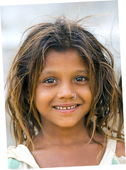 Look into my eyes... (Divs Sejpal) Tags: life portrait people india girl smile face closeup hair kid eyes child expression innocent innocence gujarat ahmedabad divs divyesh intrestingness flickrexplore explored sejpal