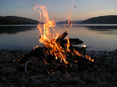 Loch Ness through fire (Citril) Tags: friends sun beach water reflections fun fire scotland friendship bbq 100v10f pebbles barbeque loch toddlers lochness 1on1 dores 2for2 thecontinuim superaplus aplusphoto searchandreward 31landscape