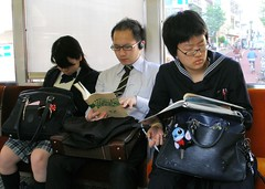 Studying in a train (tanakawho) Tags: city urban man window glass girl train bag tokyo book student uniform study learning earphone 1on1people 1on1peoplephotooftheday tanakawho superbmasterpiece twtmesh160748 1on1peoplephotoofthedaymay2007