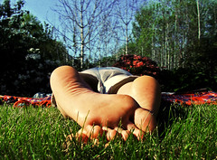 first sign of summer (scottog) Tags: summer sun feet grass tag3 taggedout garden toes tag2 tag1 relaxing alison oblivious helensburgh tartanrug