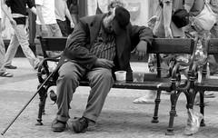 Sleeping beauty (ido1) Tags: prague globalpoverty saveme2 deleteme9 utatasolitude homeless sleep streetbench topv111 bump bench lunch cane rest weeklysurvivor