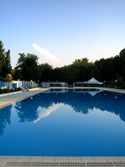 swimming pools... (Quelle night...) Tags: italy swimmingpools water blue clouds reflections catchycolors landscape nature trees