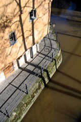 Riverside in Bamberg (:Linda:) Tags: shadow two house reflection water metal river germany bavaria town pavement bamberg franconia cobblestone sidewalk abovealtitude railing reflexion schatten manholecover weg gullydeckel birdseyeview pflasterstein shadowsontheground cobbledstone gepflastert zweigegenstnde zweidinge