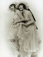 JS1562916 (Foxtongue) Tags: people halloween wearing smiling sisters portraits vintage photography clothing holding women performingarts hats siblings dresses formalwear prominentpersons relatives celebrities ribbon whites females humanrelationships gowns adults europeans headgear facialexpression costumeclothingandfashion similarity hungarians studioportraits halflengthportraits halflengthstudioportraits eveninggowns clothingaccessories monochromephotography sepiatonephotography easterneuropeans jennydolly rosiedolly