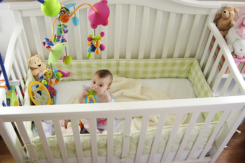 hanging out in her crib