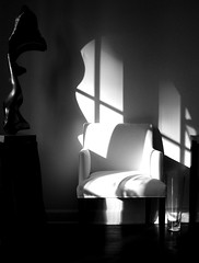 sitting (emdot) Tags: topf25 statue chair shadows vase chiaroscuro filmnoir whodunnit embadge utata:project=takeaseat