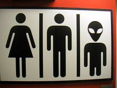 Uni-race Restroom sign