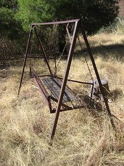 Rusty swinging bench