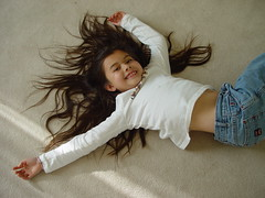 A cartwheel gone horribly wrong (Happy Tinfoil Cat) Tags: hair flickrbadge feb05 cartwheel sirena 10p top20childrensportraits doubleblooded