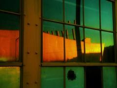 Sunset Soaked Hangar Window I (hurleygurley) Tags: california windows sunset orange reflection green abandoned window yellow 1025fav gold interestingness glow mr military hangar navy explore alameda rgb peeking base tam hg magichour notrespassing fenetres snooping anv alamedanavybase utatabluegreen elisabethfeldman