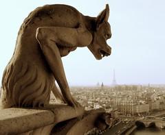 The Beauty and the Beast (color) (Hughes Lglise-Bataille) Tags: paris france topf25 statue architecture topf50 bravo dof olympus 2006 fv5 notredame gargoyle topf100 topf200 e500 topv1000 topv2000 bestlarge topv5000 abigfave