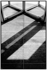 revolving door (Liquid Image) Tags: travel blackandwhite bw white black art architecture digital blackwhite nikon d100 ultrachrome utatafeature