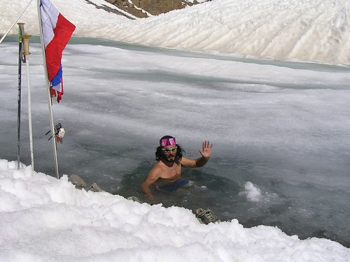 Yoga, Skiing and bathing in Himalaya, Spiti, India.