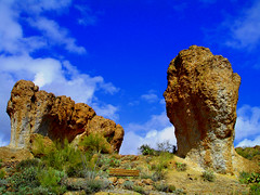 Meet the Flintstones (oybay) Tags: blue arizona mountain clouds albaluminis tan superior arboretum bluesky obelisk parkbench prehistoric flintstones primal boycethompsonarboretum abigfave favemegroup1 favemegroup2