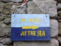 al mare (ezioman) Tags: blue sea italy water sign yellow europa europe mare blu liguria direction giallo cinqueterre azzurro lightblue corniglia