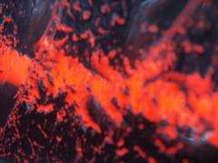 Lava (z50rc) Tags: lighting light red abstract black macro glass closeup weird bokeh ripple melbourne redblack awg catchycolorsred flourescant digitalcameraclub
