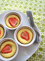 Mini-cheesecake topped with strawberries looks yummy!
