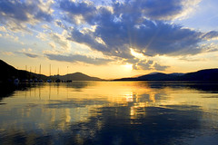 Cloudy Wrthersee Sunset (mgratzer) Tags: sunset sky sun lake color reflection boats eos austria evening cloudy ships carinthia strandbad klagenfurt whater wrthersee photobiking photocycling showonmysite