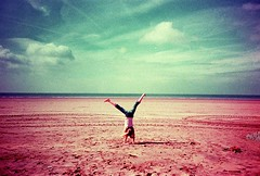 tumbling girl on Woolacombe Beach (Loulou H) Tags: beach lomo lca child devon xprocessed elitechrome woolacombe cartwheel
