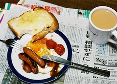 semi english (bobby stokes) Tags: food slr film newspaper tea toast meat sausages friedegg analogue heh cherrytomatoes hpsauce goodwork fullenglish slrcamera