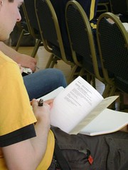 Audience member Jonathan Asebrook consults his program for the 2007 University Writing and Research Symposium. The George Washington University. Saturday, April 21.