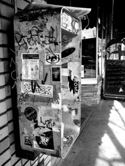 Easel (it's on the left) (Nrbelex) Tags: atlanta blackandwhite bw monochrome georgia lumix phone atl telephone stickers monochromatic panasonic payphone vandalism tizzy atlantageorgia littlefivepoints publictelephone little5points tz1 dmctz1 nrbelex
