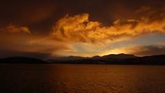 fiery sun (googlit) Tags: ocean sea sky sun mountains water norway clouds sunrise gold coast rocky explore outstandingshots