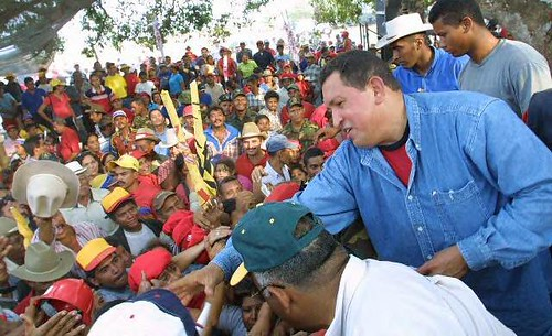 President Chavez handing out land titles to peasants in Venezuela. The Bolivarian Revolutionary government has extended home heating oil assistance to poor communities in the United States. by Pan-African News Wire File Photos