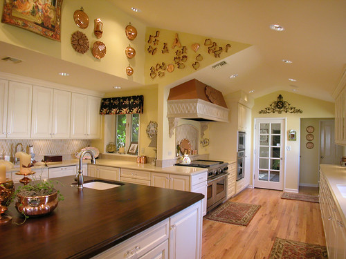 French Country Kitchen with Wood Countertop Island