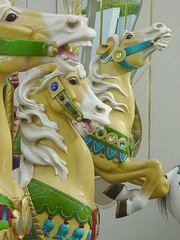 The three palomino carousel horses move up and down. (QueenHoda) Tags: sanfrancisco horse childhood carouselhorses sanfran merrygoround carouselhorse sanfranciscocarousel californiacarousels historiccarousel