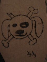 Pirate Dog burnt on wood