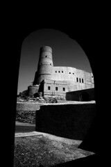 Bahla Fort Through an Arch (Photos and Art: Donna Corless) Tags: blackandwhite bw white black architecture arch fort oman donnacorless bahlafort lptowers