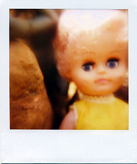 closeup creepy doll (Traci Bunkers) Tags: polaroid 600 creepydoll closeupfilters myfrontyard