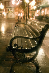 loneliness, emptiness (plousia) Tags: city winter snow wet topf25 rain night reflections bench lights town topf50 downtown loneliness bricks newhampshire dreary nh portsmouth lonely puddles
