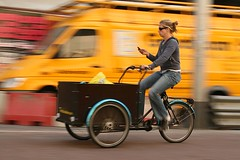 cell phone user on a cargo bike