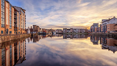 The Shore: Panorama (MilesGrayPhotography (AnimalsBeforeHumans)) Tags: architecture auldreekie autostitch panorama blending boats canon 6d canon6d 1635 ef1635mmf4lisusm city cityscape dusk edinburgh eos europe ef evening f4l glow iconic landscape longexposure le 10stopper nd nd1000 nd30 lens leith outdoors photography tranquil reflections river scotland skyline sky scenic sunset sunlight town twilight uk unitedkingdom waterscape wide waterofleith winter