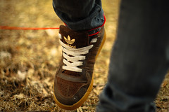 Stringing Along (Marshall Garrett.) Tags: red grass shoe weeds bokeh jeans string adidas