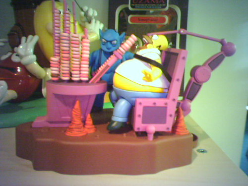 a toy representing the Simpsons Halloween Special scene in which Homer is forced to eat countless donuts in Hell Labs' Ironic Punishment Division