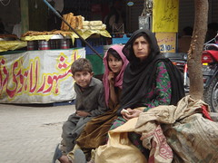 family of three (tango 48) Tags: park family pakistan food refugee melody afghan islamabad scavanger afghanrefugee foodpark