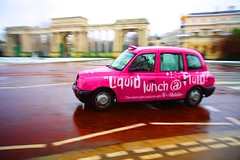 London's Pink Taxicab (Khairul) Tags: pink winter snow reflection london happy colours sweet cab taxi highsaturation pan colourful melted panning guesswherelondon aftertherain taxicab aftersnow helloladies canonefs1755mmf28isusm fortheloveofpink