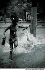 dancing in the rain (Jorge Sato) Tags: brazil bw water flood sopaulo run dancingintherain hampos semanadamobilidade jorgesato