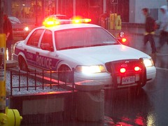 Ottawa Police Ford Crown Victoria police car with blinking lights. (Steve Brandon) Tags: city snow ontario canada cars ford wet geotagged downtown ottawa policecar autos automobiles ville centreville voitures policeofficers policemen rideaustreet precipitation  rideaust policecruiser patrolcar crownvic fordcrownvictoria pushbar  flashinglights policiers policeinterceptor 2826 ottawaphotography ottawapolice ottawapoliceservice ruerideau    ottawaphotographer
