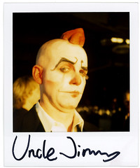 uncle jimmy again (flybutter) Tags: film polaroid fancy fundraiser slr680 doublechin emcee lmcc 7worldtrade unclejimmy 779 flybutter 52ndfloor downtowndinner lowermanhattancreativecouncil