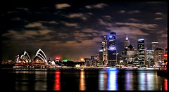 Glowing Opera House and Sydney City (say.fromage) Tags: city longexposure reflection water night clouds canon reflections office still cityscape searchthebest harbour sydney australia calm nighttime highrise operahouse sydneyharbour 30d buiildings anawesomeshot