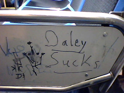 Daley Sucks, says the back of the bus