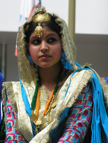 Punjabi Indian Bhangra dancer in traditional dance costume