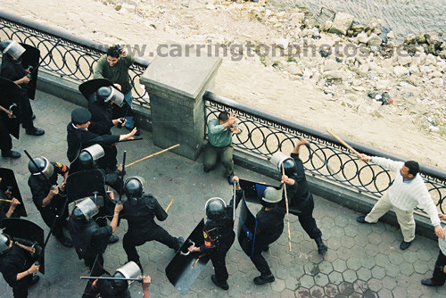 Central Security Forces and plainclothes Gestapo beating a demonstrator