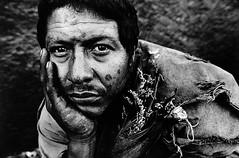 man with dead flowers, tijuana (mexadrian) Tags: flowers portrait white man black flores blanco dead y noiretblanc retrato negro border muertos frontera hombre accepted1of100bw