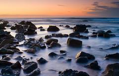 Milky Rocks (Ev Lloyd) Tags: ocean longexposure morning sea water sunrise rocks anawesomeshot impressedbeauty shackbay ultimateshot flickrdiamond